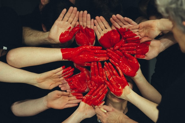 people making a heart image